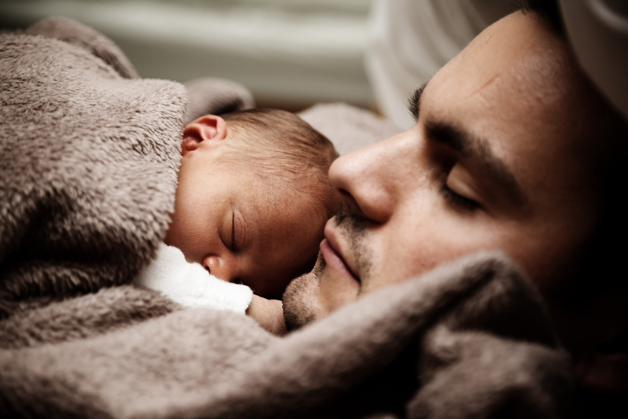Man with a newborn baby